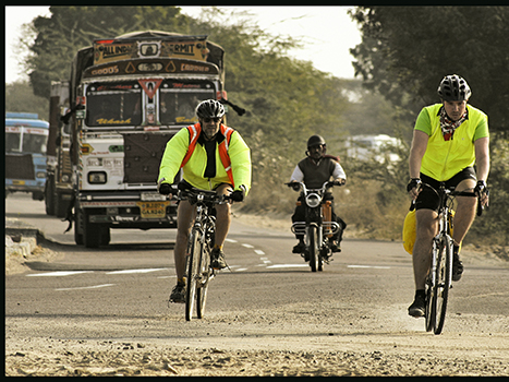 India Cyclists in front of bus